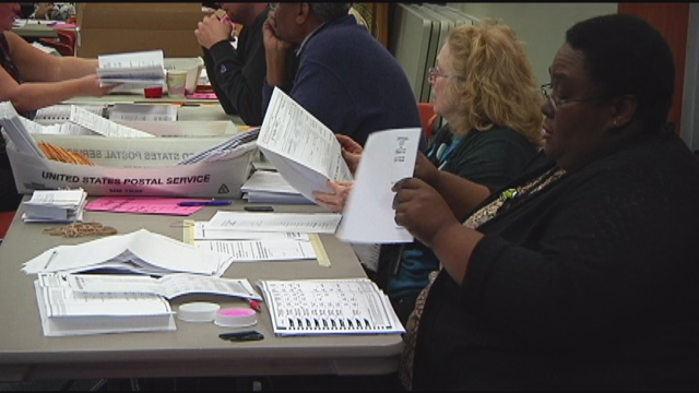 County elections officials counted absentee ballots on Thursday
