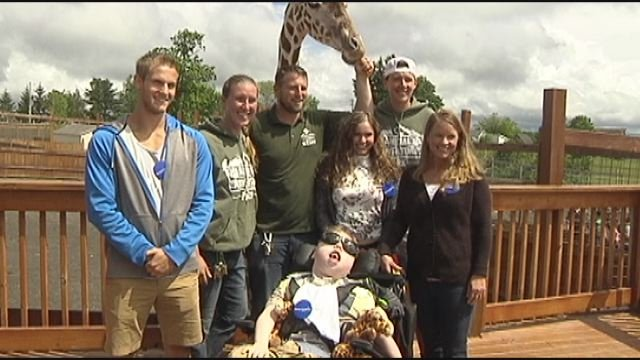 Boy with seizure disorder gets wish, meets April the giraffe and calf